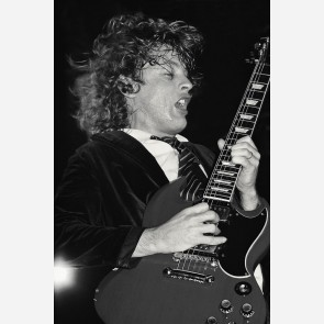 Angus Young of AC/DC by Ken Settle